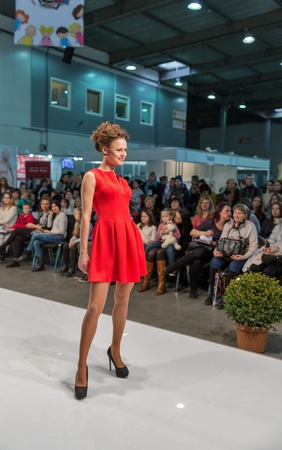 KIEV, UKRAINE - FEBRUARY 04, 2016: Fashion model at Kyiv Fashion 2016 show in KyivExpoPlaza exhibition center. It was the 30th edition of the popular Kyiv Fashion International Vogue Festival.