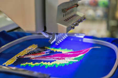 Photo pour Professional machine for applying embroidery on different tissues closeup - image libre de droit