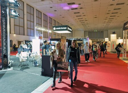 Photo pour BERLIN, GERMANY - OCTOBER , 2019: People visit 23th Venus trade fair in Messe exhibition hall. Annual trends and innovations from the erotic and lifestyle sectors was presented here. - image libre de droit