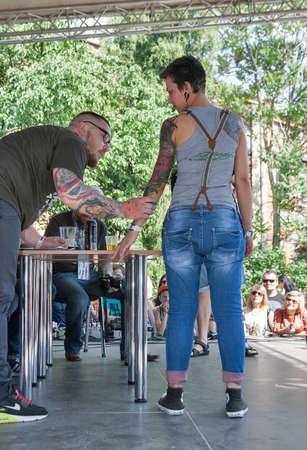 KIEV, UKRAINE - MAY 23, 2015: Jury assesses tattoo of the participants during International Tattoo Convention Kyiv Tattoo Collection 2015 organized by Planeta Tattoo studio in Art-factory Platforma.
