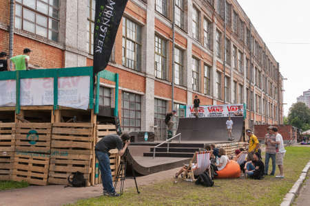 KIEV, UKRAINE - MAY 23, 2015: Sport competition with skateboarders jumping on a ramp at International Tattoo Convention Kyiv Tattoo Collection by Planeta Tattoo studio in Art-factory Platforma.