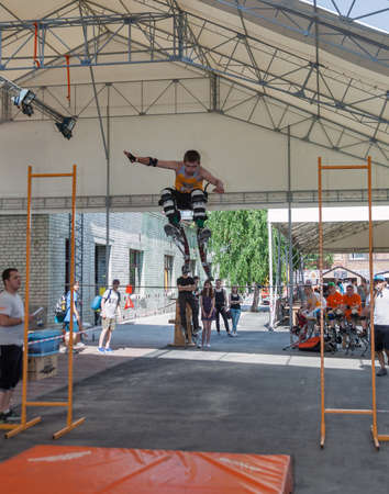 KIEV, UKRAINE - MAY 23, 2015: Sport competition with jumping stilts at International Tattoo Convention Kyiv Tattoo Collection 2015 organized by Planeta Tattoo studio in Art-factory Platforma.