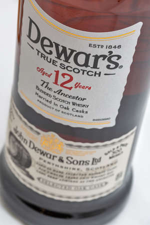 Photo pour KYIV, UKRAINE - AUGUST 17, 2019: Dewar's True Scotch The Ancestor aged 12 years blended Scotch Whisky bottle closeup. Dewar's whiskies have won more than 400 awards and medals in over 20 countries. - image libre de droit
