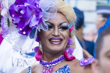 SAO PAULO, BRAZIL - June 7, 2015: An unidentified Drag Queen dressed in a costume celebrating lesbian, gay, bisexual, and transgender culture in the 19th Gay Pride Parade Sao Paulo