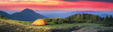 High in Ukraine - Marmarosh mountain when the snow melts and becomes warmer - in the spring summer is pleasant to put up tents on the top of the mountain - it\'s fantastic fantastically beautiful romantic