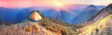High in Ukraine - Marmarosh mountain when the snow melts and becomes warmer - in the spring and summer is pleasant to put up tents on the top of the mountain - it\'s fantastic fairytale beautiful and romantic