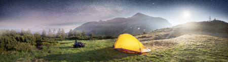 High in Ukraine - Marmarosh mountain when the snow melts and becomes warmer - in the spring summer is pleasant to put up tents on the top of the mountain fantastic beautiful romantic