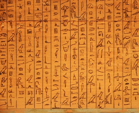 ancient Egyptian hieroglyphic panel carved in wood
