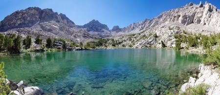 Panorama of unnamed Sierra Nevada mountain lake and Dragon Peak