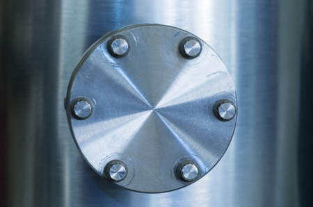 Photo pour bolted on flange cover on an industrial brushed metal vacuum pipe - image libre de droit
