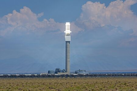 the Crescent Dunes concentrated solar power plant with heliostat mirrors focusing the solar energy onto the central power tower