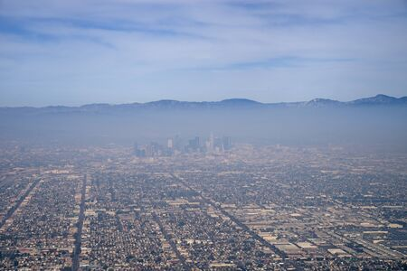 downtown Los Angeles from the air viewed through a layer of smog pollution