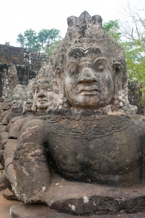 the ancient graven guardian to  Angkor Thom in Cambodia