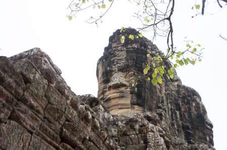 the ancient engraving door to Angkor Thom temple in Cambodia