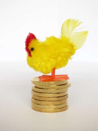 Hen laying golden eggs