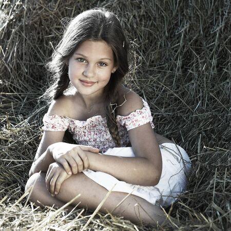 A little girl is in the field