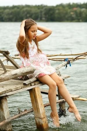 Little girl a park near the river