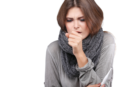 woman taking her temperature wile feeling sick and with fever, isolated on a white background