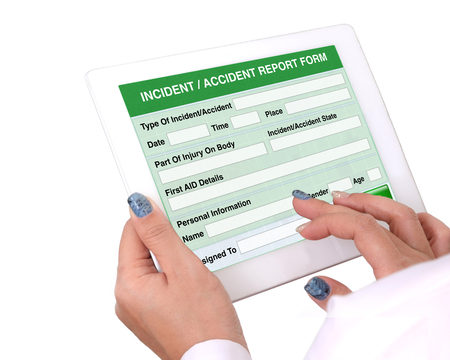 Photo pour Doctor holding tablet computer in hand that show the report form of Incident or accident information on white background. - image libre de droit