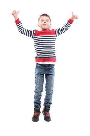 Photo for Jumping excited little boy in mid air celebrating success or victory. Full body portrait isolated on white background. - Royalty Free Image
