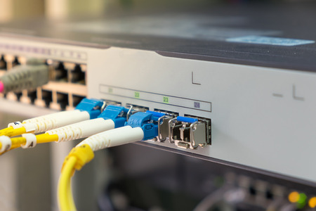 optical fiber cables plug in in network switch