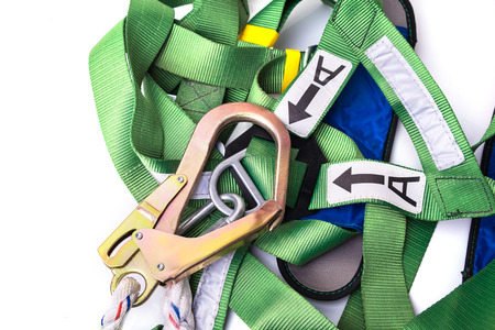 Photo for Closeup fall protection harness and lanyard for work at heights on white background.Closeup at safety hook. - Royalty Free Image