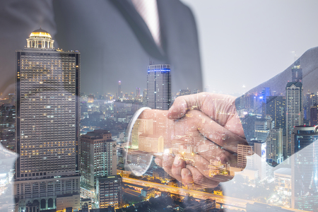 Foto de Double exposure of Business handshake ,Investment concept - Imagen libre de derechos