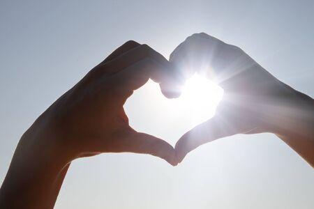 Photo for Hands in shape of love heart - Royalty Free Image