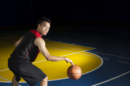 Asian young basketball player on basketball court