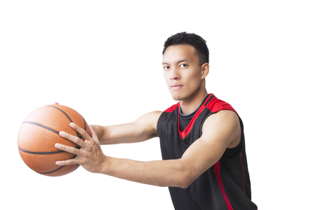 Asian young basketball player on white background