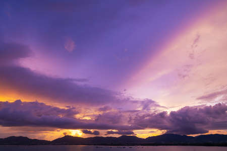 Foto de Dramatic clouds in sunset or sunrise over the mountains and the sea of Phuket islands in Thailand. - Imagen libre de derechos
