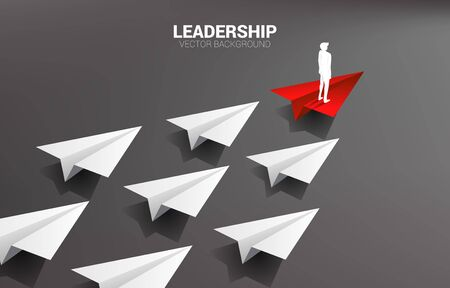 Illustration pour Silhouette of businessman standing on red origami paper airplane leading group of white. Business Concept of leadership and vision mission. - image libre de droit