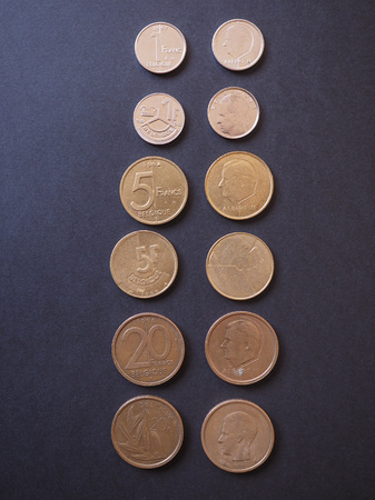 Belgian franc (BEF) coins from Belgium written in French and Dutch. BEF was replaced by EUR in 2002
