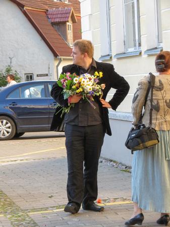 TALLINN, ESTONIA - CIRCA JUNE 2012: elegantly dressed people at a graduation ceremony