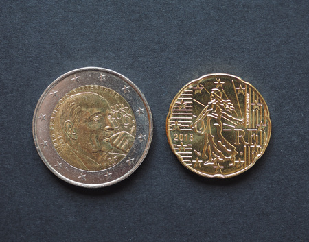 Euro coins money (EUR), currency of European Union bearing the portait of Francois Mitterand late president of France (1981-1995) and Marianne, national symbol of the Republic, freedom and reason