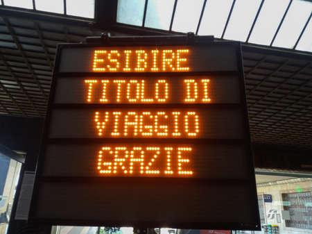 Foto per FLORENCE, ITALY - CIRCA APRIL 2019: Esibire titolo di viaggio (translated:   Please show your ticket ) at main railway station - Immagine Royalty Free
