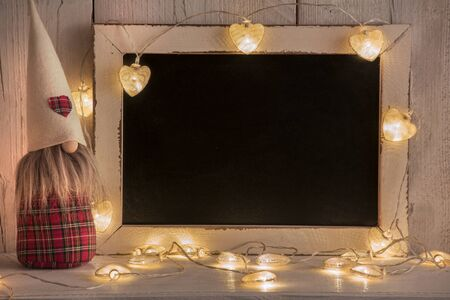 Photo pour a background for Christmas texts with lights and gnomes - image libre de droit