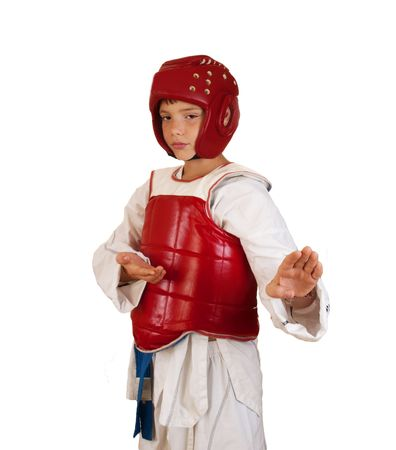 The boy in sportswear for employment taekwondo on a white background