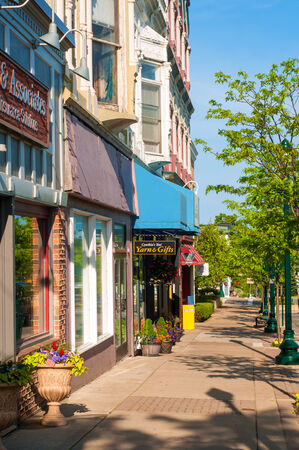 Photo for PETOSKEY, MI - JUNE 27: Shops and businesses along Mitchell Street (observer facing west) in Petoskey - Royalty Free Image