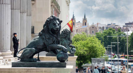 Madrid, Spain; 05/31/2018: The lions of the Congress of Deputies are two bronze sculptures that symbolically protect the entrance to the Courts and are on the main facade guarded by a police