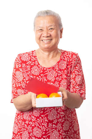 Photo pour Old woman and Chinese new year. - image libre de droit