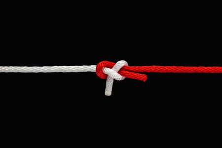 Photo for Tie the knot with red and white rope on black background with clipping path - Royalty Free Image