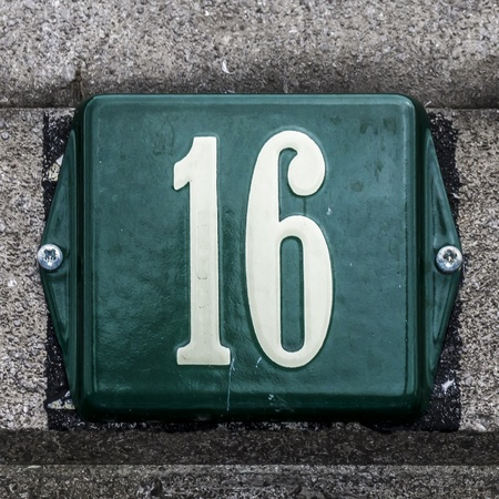 green white enameled house number sixteen