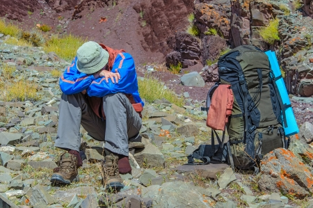 Trekker resting in height mountain  India