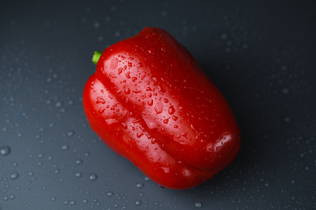 Photo for Red bell pepper on dark background with water drop - Royalty Free Image