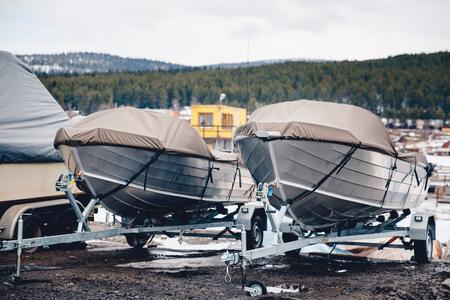 Photo pour shrink wrapped power boat in autumn woods - image libre de droit