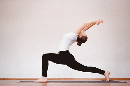 Photo pour Yoga Concept. Close up woman meditates while practicing yoga in training hall or home. - image libre de droit