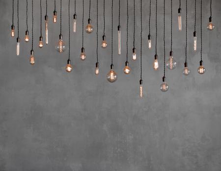 Photo pour Edison retro lamp Incandescent bulbs on gray plaster wall background in loft. Concept Vintage style. Copy space - image libre de droit