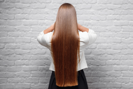 Photo pour Portrait of Beautiful Young brunette woman with long straight in flight air. Concept loss hair - image libre de droit