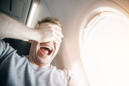 Foto de Concept aerophobia. Afraid of fear flying on an airplane and at height. - Imagen libre de derechos